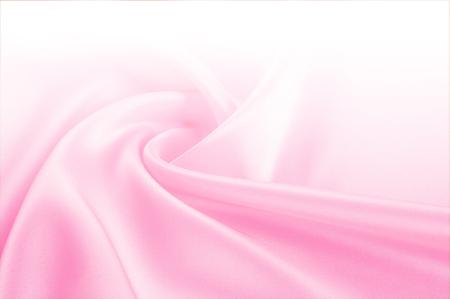 Texture, arrière-plan, motif. Beige clair, tons roses de tissu en soie, espace de texte. Fond de soie rose basé sur une texture naturelle