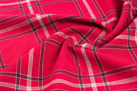 texture, pattern. Scottish tartan pattern. Red and black wool plaid print as background. Symmetric square pattern. yarn dyed flannel is brushed on both sides and perfect for button down shirts,
