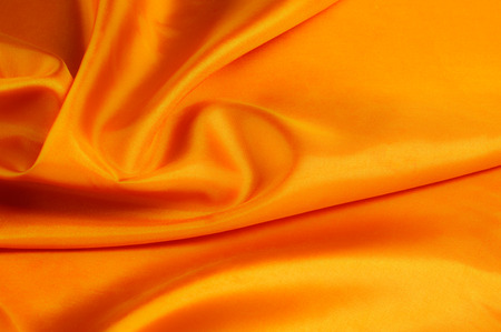 Soft focus. texture golden-red silk fabric. Bright, bold and noisy, this is perfect for this extroverted personality A wise man and a golden foggy floral print filled the top of the reddish background