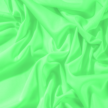 Texture. Background. Template. Cloth - silk green. Known extravagance, this Green silk taffeta is nothing more than a word. Luminous light green fabric is a crispy hand, inherent in tafeta.