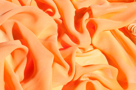 Background texture pattern. Silk crepe of chiffon peach peachpuff Introducing the sultry and stunning  Silk Satin you see here. Duchess satin is a gorgeous high-fiber count medium-bodied low luster