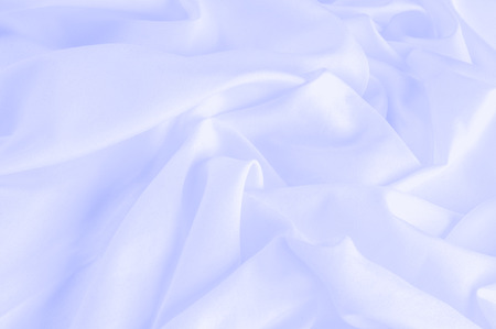 Soft focus. texture, pattern. fabric silk pastel, blue. Floral and fabulous! Spring is coming, and what better way to cover the season with this thin silk chiffon for your design. Stock Photo