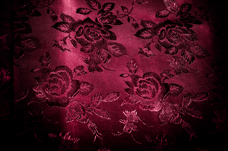 fabric, background texture. silk red fabric with a pattern of flowers. Add an exotic flash to your look with this Persian red abstract printed font SIlk Charmeuse.