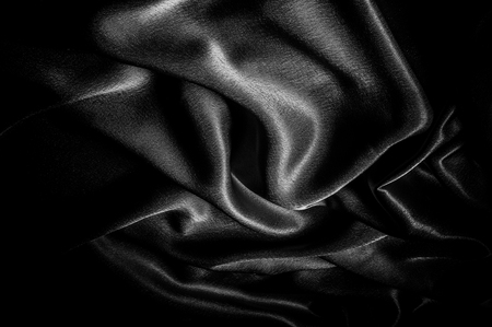 texture, pattern. Fabric made of silk fabric is black, This metallic black abstract jacquard is as magical as a mermaid under the water. The luminous metallic shade is mixed with the spray of color
