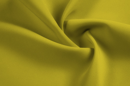texture, pattern. Mustard silk fabric. Deep tone for autumn and winter, add this silk chiffon for your design. Light and airy, use its uplifting drapery to create easily flowing pieces. 写真素材