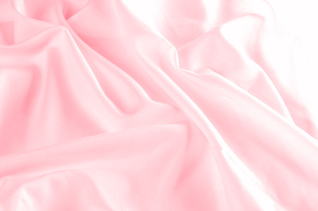 background texture. silk fabric pink. This Powder Pink Silk Woven gives an aura of a springtime romance. Its gentle tone presents a satin-like face making it smooth and luminous.  写真素材