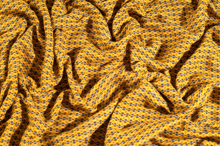 Fabric cotton is brown with a pattern of circles. Smooth and chic but still on the wild side, do not miss this Python Printed Stretch Cotton Sateen With a smooth crisp hand this cotton shows diamonds