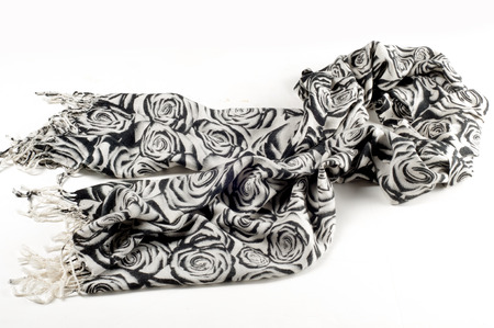 Texture, background, pattern. A woolen scarf, black and white, roses are drawn on a scarf. Woolen black and white fabric.100% pure virgin wool & authenticity labels black white houndstooth