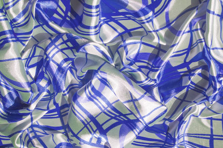 Silk. The fabric is white in steel, the fabric is colored with blue lines. Fix it with this exciting patchwork ! This material is slightly transparent, pleasantly soft and contains an elegant drapery.