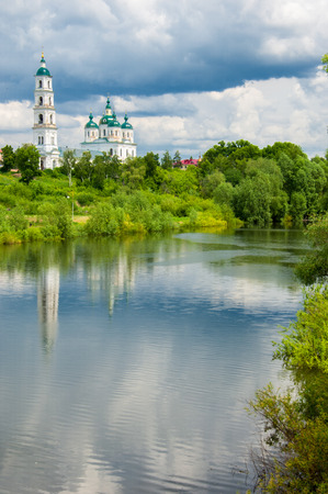 Orthodox church Flood. Natural disaster - the flooding of the land with water, which originated from the coast. Trees of bushes are in the water. Receipt of insurance benefits