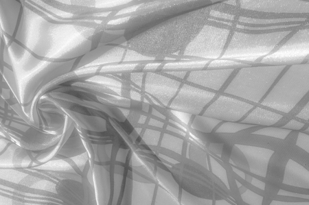 blurred. Background texture Silk. The fabric is white in color from steel, aluminum, titanium, silver. Tokka brought you one fabulous silk chiffon. Steel gray and thin, white, striped appearance.
