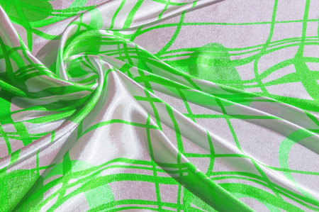 Silk. The fabric is green in steel, the fabric is colored with green lines. Fix it with this exciting patchwork ! This material is slightly transparent, pleasantly soft and contains an elegant drapery Reklamní fotografie