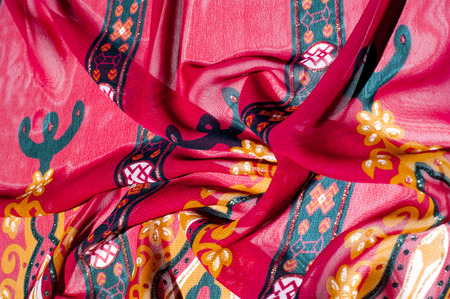 Background texture, pattern. Red maroon fabric. Click on your local heritage with this red, bard and yellow striped silk. This patterned fabric will decorate your design. your work will be exclusive