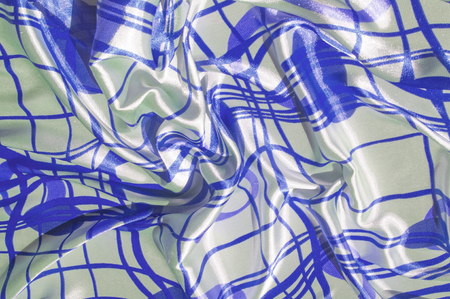 Silk. The fabric is white in steel, the fabric is colored with blue lines. Fix it with this exciting patchwork ! This material is slightly transparent, pleasantly soft and contains an elegant drapery