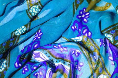 Background texture Blue silk fabric with a pattern. this light silk braided can be turned into your design. With the help of several segments from this print, you can get precious samples of your work 写真素材