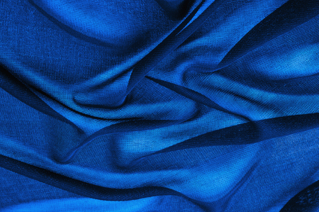 Texture, background, pattern. Blue transparent fabric. Crystal organza has a grainy shine and feel compared to the mirror organza, which has a smoother shine/reflection and feel. Stockfoto