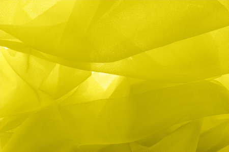 texture background, tulle yellow. Solid nylon tulle oil. With a simple screensaver in your design, create a couture appearance that refers to the softness of spring.