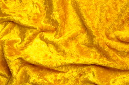 Texture, background, pattern. Cloth velvet yellow. This gorgeous stretch velour fabric has a velvety pile.The panne nap adds shimmer and texture!