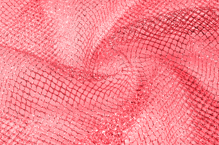red silver mesh fabric, with a woven metallic thread Celebrate sports aesthetics with this silver red novelty With a similar body and weight it falls on some volume adding geometric texture and design 写真素材