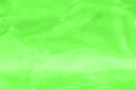 fabric, background texture. Silk green, salad, cloth. Mood of U classes. This shiny material has a really soft and smooth surface texture that is guaranteed to add style and glare to your design