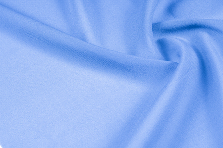 Background texture, pattern. silk cloth light blue. Vintage French sateen silky fabric in a lovely light teal color.