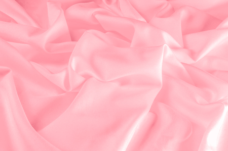background texture. silk fabric pink. This Powder Pink Silk Woven gives an aura of a springtime romance. Its gentle tone presents a satin-like face making it smooth and luminous.  Stok Fotoğraf