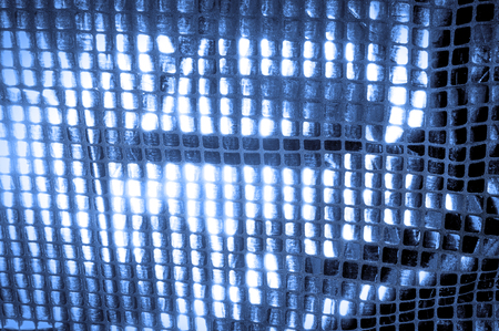 texture, background, pattern. Fabric with big sparkles of blue color. Show some style with these sporadic sparkles! Dispersed on a polyester mesh substrate, there are blue and white sequins,
