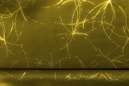 texture Silk fabric Golden yellow with a pattern. Add an unexpected shine of sophistication when introducing this mustard velvet. Soft light velvet depicts a playfully twirled design in decadent gold. Stok Fotoğraf