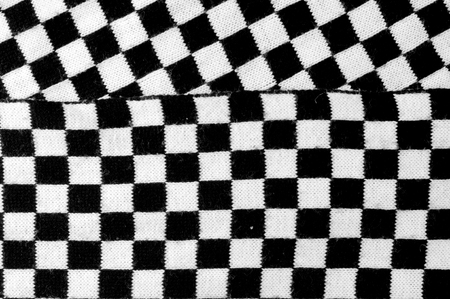 Texture, background, pattern. Scarf shawl tippet plaid white and black cell. a womans long scarf or shawl, worn loosely over the shoulders.