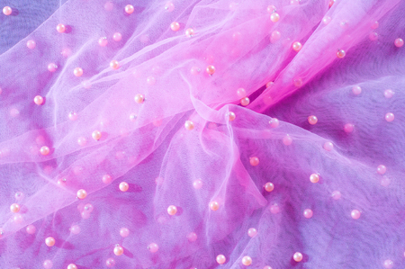Pink translucent fabric embroidered with beads. Get a red carpet with this lace lace of beads Couture! Luminous beads, sequins and rhinestones are woven throughout the fine grid