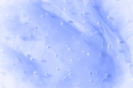 Blue, blue translucent fabric, embroidered with beads. Perfect for your design, this incredibly luxurious material is perfect for your next special project! Stock Photo