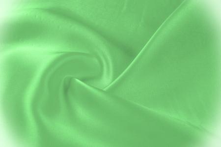 テクスチャ、パターン。生地は絹のような緑色です。このカロライナストーングリーンシルクファイロムであなたの優れたデザインを更新します。タフタに体のように、それは微妙な光沢を作成する滑らかな腕を持っています。 写真素材 - 96331414