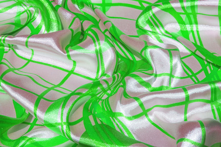Silk. The fabric is green in steel, the fabric is colored with green lines. Fix it with this exciting patchwork ! This material is slightly transparent, pleasantly soft and contains an elegant drapery 写真素材