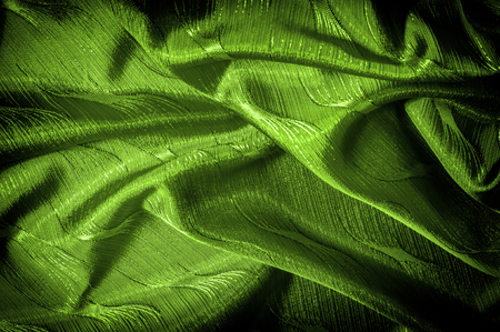 silk cloth green color On the fabric is a pattern of threads Definitely a unique detail this green abstract laminated silk fabric is worth seeing! Smooth silk has a laminated finish  glossy appearance