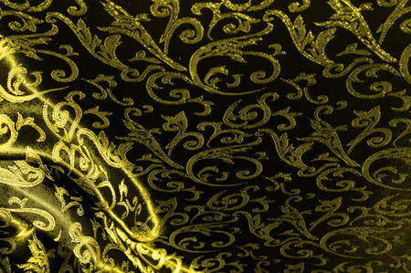 silk cloth Royal monogram. Yellow is dark. This is a black silk velvet with a royal gold seal, creating a negative space patterned picture. Light weight, great for design. Stock fotó