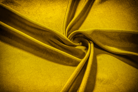 Texture background cloth silk yellow With an elegant shine this beautiful material will bring generosity in any applications With such a crispy drapery this satin necessarily adds to any design