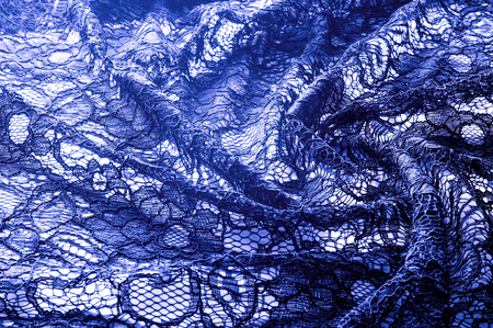 Texture, background, pattern. Cloth of blue lace. Background of fabric from lace stylized roses. Abstract lace pattern with flowers. Wallpaper, underwear and jewelry. Your invitations