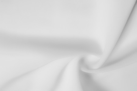 texture. silk fabric is dense, white. Ivory in color, this mixed silk and polyester lightweight taffeta is distinguished by glitter on both sides of the fabric, which perfectly caresses the light. Stock Photo