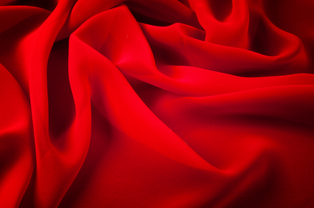 silk fabric red. Silk organza mood is an exceptional fabric that looks beautiful in itself or as a supporting player when used as an underscore or to provide greater support and design structure Stock Photo