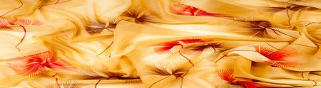 12 September 2015. Nabeorezhnye Chelny Tatarstan RussiaSilk fabric texture, background, yellow, light beige, beige, apricot, white flowers pattern. abstract drawing