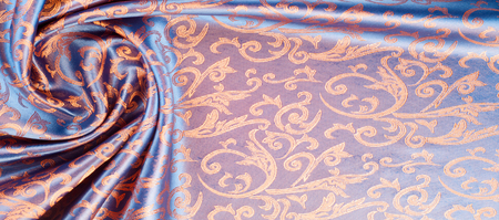 The texture of the silk fabric. Yellow Orange, Gold, Almond, Neon Carrot,  a fine, strong, soft, lustrous fiber produced by silkworms in making cocoons and collected to make thread and fabric.