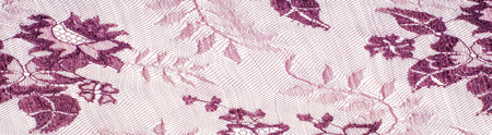 Texture lace fabric. lace on white background studio. thin fabric made of yarn or thread. typically one of cotton or silk, made by looping, twisting, or knitting thread in patterns