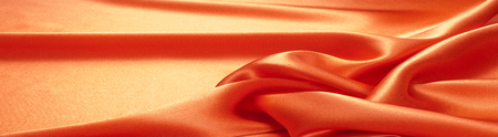 Red silk fabric tecture.  for Drapery Abstract Background. Smooth elegant red silk.  Stock Photo