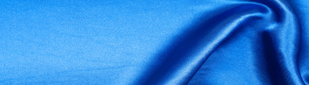 fabric silk texture. background. blue color. a fine, strong, soft, lustrous fiber produced by silkworms in making cocoons and collected to make thread and fabric.