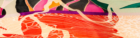 Fabric silk texture. abstract painting. bstract wave pattern on silk batik. a fine, strong, soft, lustrous fiber produced by silkworms in making cocoons and collected to make thread
