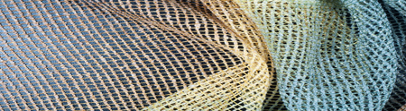 Cotton fabric texture. colored transparent mesh 免版税图像