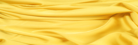 Texture, pattern. Drawing. Silk fabric is yellow. This list is intended for exquisite and beautiful pure silk fabric dupioni in yellow color.