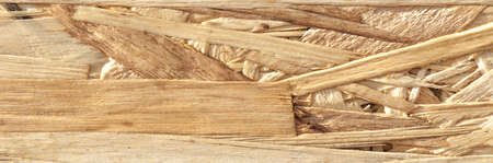 Texture background Macro photography Close up. Particle board – also known as particleboard, low-density fibreboard LDF, and chipboard – is an engineered wood product manufactured from wood chips