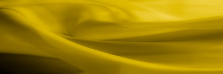 Texture, background, pattern. Yellow transparent silk fabric. Sunshine Yellow Silk Charmeuse Satin, Stock Photo