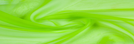 texture background template Green silk transparent fabric. Incredibly soft and thin, do not miss this chiffon chiffon. this chiffon is juicy and transparent Align this fabric with its suitable charm!
